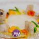 Bombolles d'oli de galera amb llagostins al bufador (soplete) i verdures